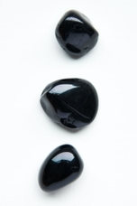 Black Tourmaline Tumbled Stones - Earthbound Trading Co.
